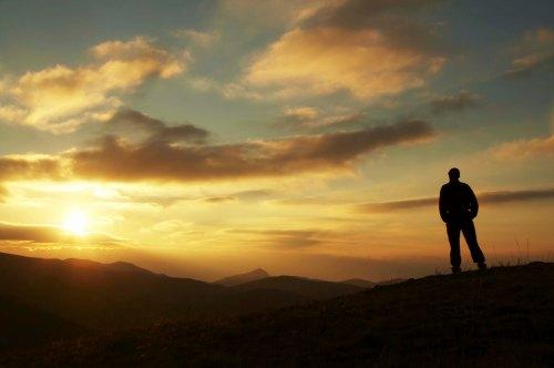 Male silhouette on sunrise