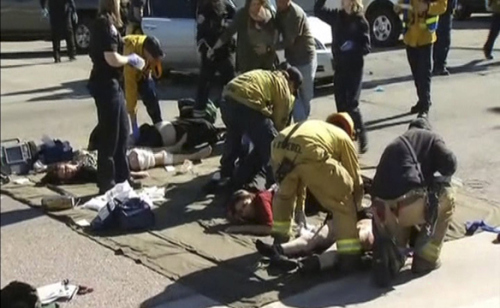 Rescue crews tend to the injured in the intersection outside the Inland Regional Center in San Bernardino, California in this still image taken from video December 2, 2015. At least 20 people were reported injured in an active shooter situation, according to news reports. REUTERS/NBCLA.com/Handout via Reuters NO SALES. FOR EDITORIAL USE ONLY. NOT FOR SALE FOR MARKETING OR ADVERTISING CAMPAIGNS. THIS IMAGE HAS BEEN SUPPLIED BY A THIRD PARTY. IT IS DISTRIBUTED, EXACTLY AS RECEIVED BY REUTERS, AS A SERVICE TO CLIENTS NO RESALES. NO ARCHIVE